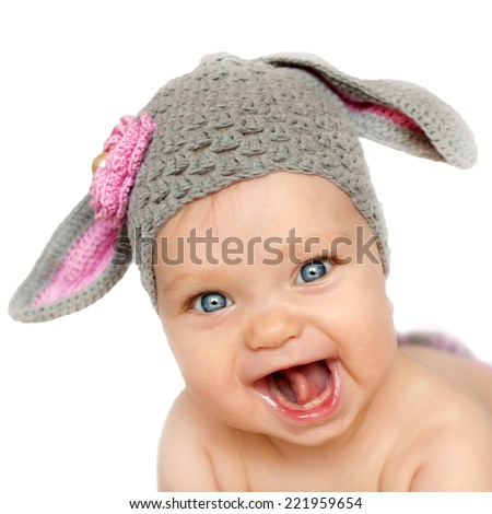 Portrait of smiling baby in the hat like a bunny or lamb. Isolated on white background - stock photo