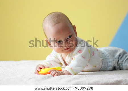 Portrait of Smiling Baby with toy - stock photo