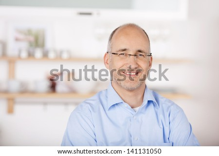 Portrait of smiling bald man at home background - stock photo