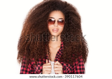 Portrait of smiling beautiful african american girl with long curly hair. Girl wearing sunglasses . - stock photo