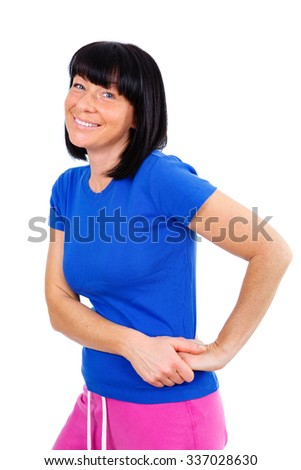 Portrait of smiling beautiful brunette women 40 years old, posing in blue T-shirt and sport pants. Ready for your design, isolated on white background - stock photo