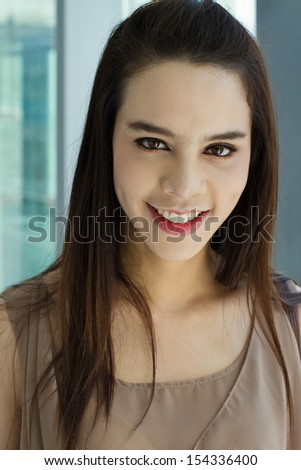 portrait of smiling beautiful female with positive attitude