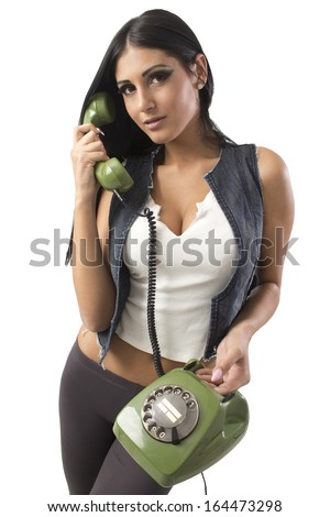 Portrait of smiling beautiful woman talking on retro telephone