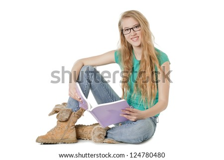 Portrait of smiling beautiful young woman holding a book - stock photo