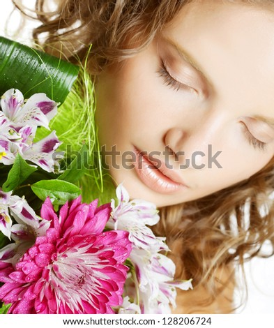 Portrait of  smiling beautiful young woman with bouquet flowers
