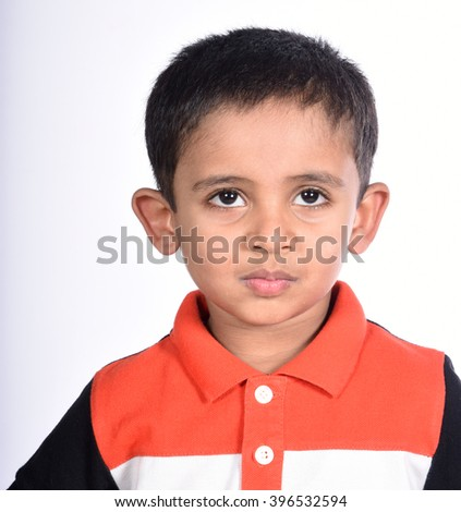 Portrait of smiling boy in action on white background
