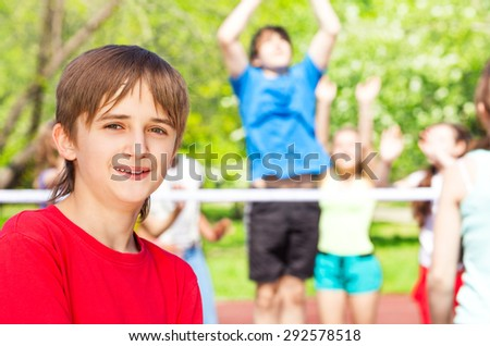 Portrait of smiling boy standing on playground - stock photo