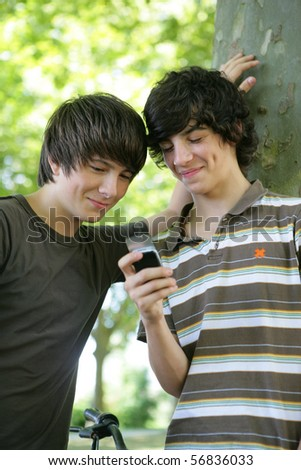 Portrait of smiling boys with a mobile phone
