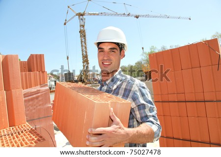Portrait of smiling bricklayer