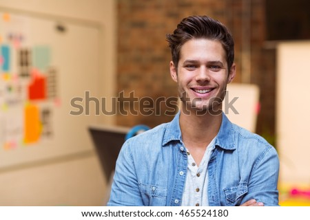Portrait of smiling business executive standing in office