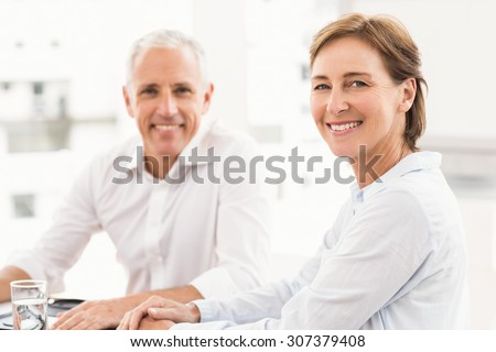 Portrait of smiling business partner making an arrangement in the office - stock photo