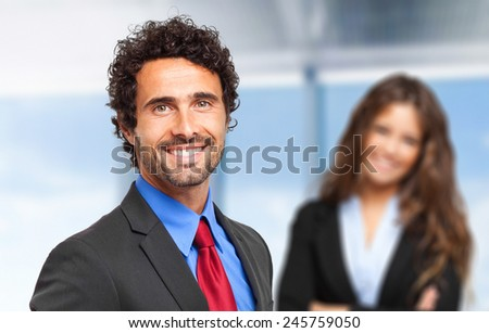 Portrait of smiling business people - stock photo