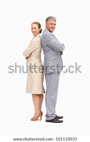 Portrait of smiling business people back to back against white background