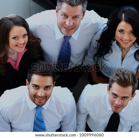 Portrait of smiling business people. Top view.