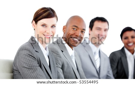 Portrait of smiling business team during a presentation against a white background - stock photo