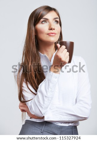Portrait of smiling  business woman, isolated on gray background with coffee cup. - stock photo