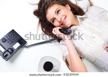 Portrait of smiling business woman on phone call