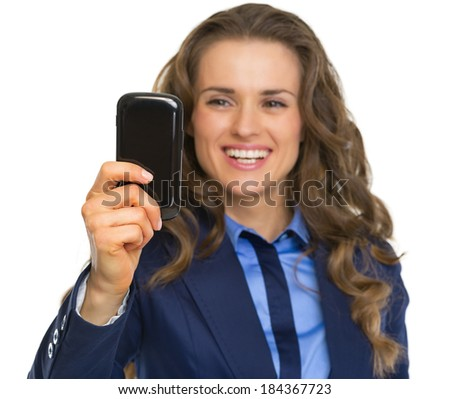 Portrait of smiling business woman taking photo with cell phone