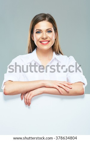 Portrait of smiling business woman with blank white sign board. Isolated studio portrait. - stock photo