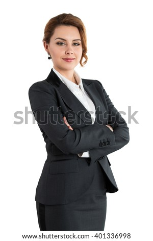 Portrait of smiling business woman with folded hands isolated on white background. Female wearing grey formal suit standing with her arms crossed. Business lifestyle and success concept - stock photo
