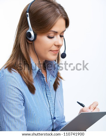Portrait of smiling business woman with headset. Isolated portrait. Office Worker writes down on paper