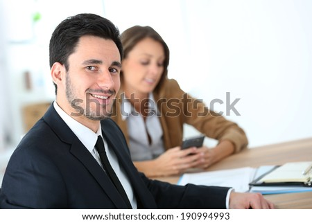 Portrait of smiling businessman having a meeting