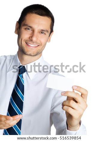 Portrait of smiling businessman showing blank business or credit card, isolated against white background. Success in business, job and education concept studio shot.