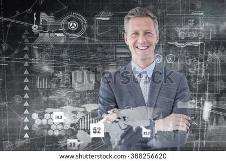 Portrait of smiling businessman standing hands folded against hologram background - stock photo