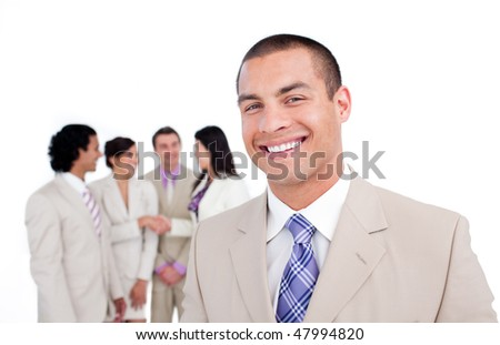 Portrait of smiling businessman with his team on the background - stock photo