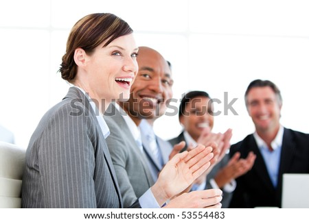 Portrait of smiling businessteam applauding a presentation against a white background - stock photo