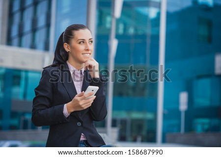 Portrait of smiling  businesswoman, on the modern building background