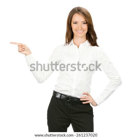 Portrait of smiling businesswoman showing something, isolated against white background - stock photo