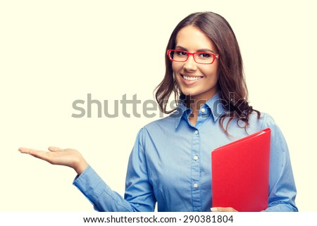 Portrait of smiling businesswoman showing something or holding, with blank copyspace area for slogan or text, with red folder - stock photo