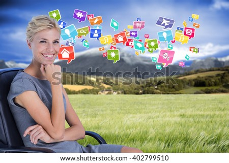 Portrait of smiling businesswoman sitting on chair against scenic backdrop