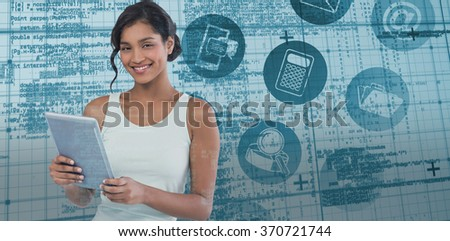 Portrait of smiling businesswoman using tablet computer against blue matrix and codes
