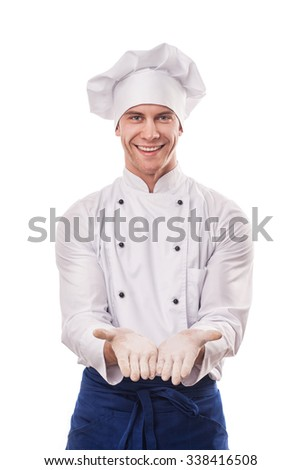 Portrait of smiling chief cook with hands sign isolated on white