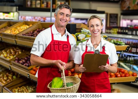 Portrait of smiling colleagues at supermarket - stock photo