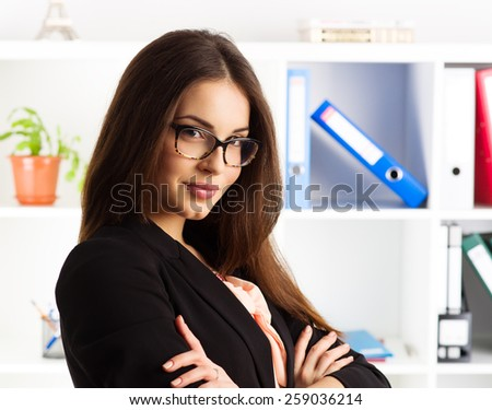 Portrait of smiling confident female company's director wearing eyeglasses and business suit. Concept of competence and professionalism.   - stock photo