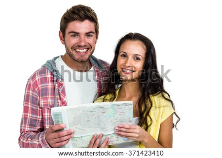 Portrait of smiling couple holding map on white screen - stock photo