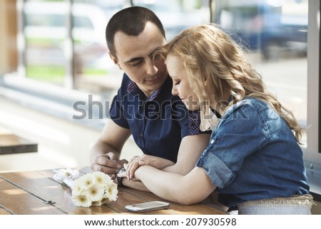 Portrait of smiling couple in cafe - stock photo