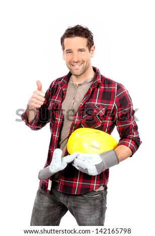 portrait of smiling craftsman thumbs up sign - stock photo
