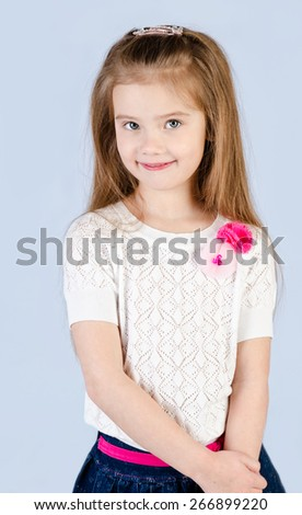 Portrait of smiling cute little girl isolated  - stock photo