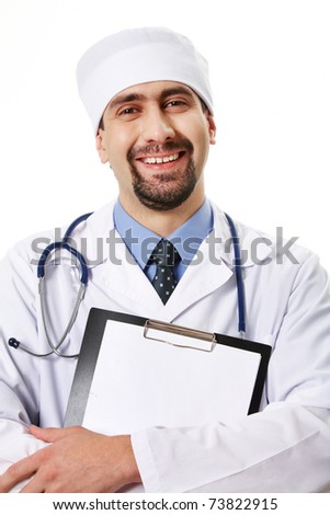 Portrait of smiling doctor with clipboard in hands looking at camera