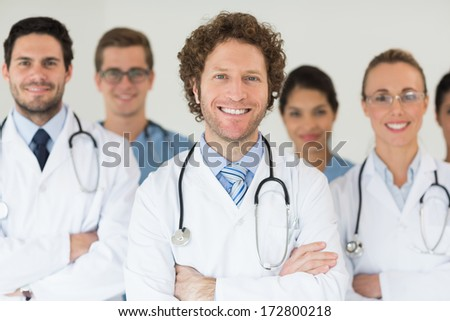 Portrait of smiling doctors and nurses in hospital - stock photo