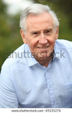 Portrait of smiling elderly man