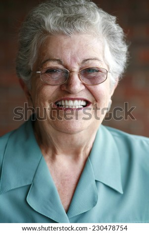 Portrait of smiling elderly woman. - stock photo