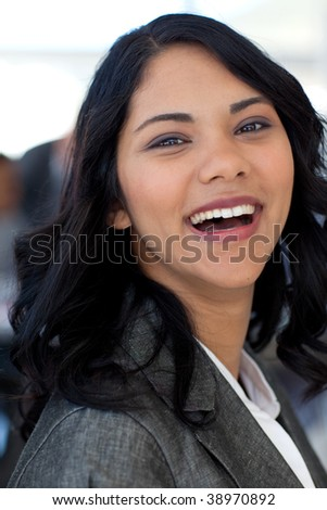 Portrait of smiling ethnic businesswoman working in office