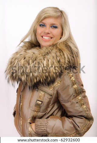 Portrait of smiling fair-haired woman in fur coat