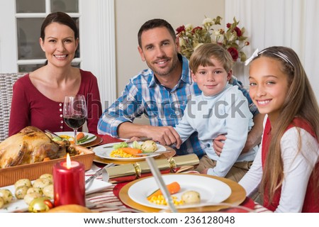 Portrait of smiling family during christmas dinner at home in the living room