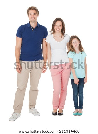 Portrait of smiling family isolated over white background - stock photo